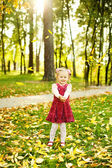 Little girl in autumn park (soft focus, focus on eyes of baby) — Stock Photo