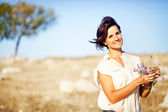 Beautiful and natural adult woman outdoors — Stock Photo