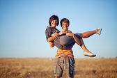Mother with adult son on the field — Stock Photo
