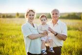 Grandparents and grandchild — Stock Photo