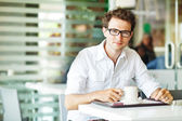 Man in cafe with coffee — Stock Photo