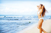 Young caucasian woman on the beach, bali — Stock Photo