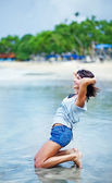 Young beautiful brunette woman on the beach — Stock Photo
