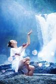 Young woman near waterfall, bali, indonesia — Stock Photo