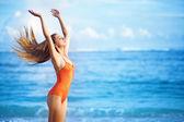 Young beautiful woman on the sand near ocean, Bali, Indonesia — Stock Photo