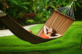 Young beautiful woman in hammock, Bali, Indonesia — Stock Photo
