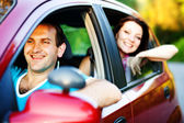 Happy smiling couple in a car. Driving. — Foto de Stock