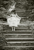 Beautiful girl on the stairs — Stock Photo