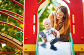 Mother and son on playground — Stock Photo