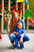 Ginger mother with baby — Stock Photo