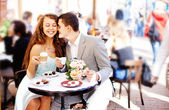 Cafe couple drinking talking having fun laughing smiling happy — Zdjęcie stockowe