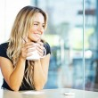 Woman drinking coffee in the morning at restaurant — Stock Photo
