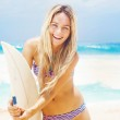 Surfer girl on the beach of bali — Stock Photo