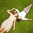 Couple laying on the grass — Stock Photo #26365041