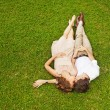 Couple laying on the grass — Stock Photo