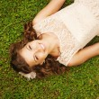 Cute woman lying on the grass — Stock Photo
