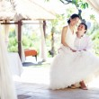Couple in gazebo on wedding day — Stock Photo