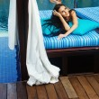 Beautiful woman relaxing on lounger in hotel, bali — Stock Photo