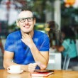 Young entrepreneur or student working in a cafe — Stock Photo