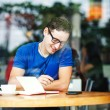 Young entrepreneur or student working in a cafe — Foto Stock