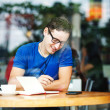 Young entrepreneur or student working in a cafe — Stock Photo #26366099
