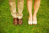 Feet and shoes of newlyweds — Stock Photo