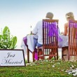 "Romantic dinner - back view (soft focus on the ""just married"" text) — Stock Photo"