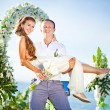 Cheerful bride and groom on the wedding venue outdoors — Stock Photo #30761769