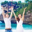 Wedding on the beach with flower petals — Stock Photo