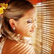 Pensive woman in the light of tropical sun on a vacation (soft focus on her eyes and lashes) — Stock Photo