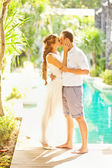 Adorable couple in sunlight on their wedding day (sort focus) — Стоковое фото