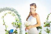 Bride in a flourish arch on the wedding venue, bali — Stock Photo