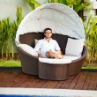 Man relaxing in summer on back yard of his house — Stock Photo #33575813