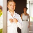 Groom and bride preparing in the morning — Stock Photo
