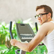 Man cycling in gym — Stock Photo