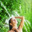 Woman having shower under tropical waterfall, bali — Stock Photo