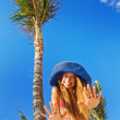 Summer holidays concept - woman under the exotic palm tree — Stock Photo
