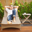 Handsome mon lounger in garden — Stock Photo #33575825