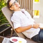 Man having breakfast in garden in summer — Stock Photo #33575857