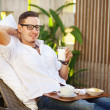Man having breakfast in garden in summer — Stock Photo