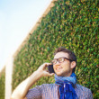Stock Photo: Casual min city calling by phone
