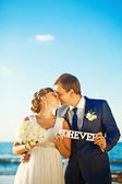 "Wedding couple holding word ""forever"" — Stock Photo"