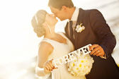 """Love forever concept - wedding couple holding the word """"forever"""" — Stock Photo"""