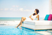 Woman on sunbed — Stock Photo