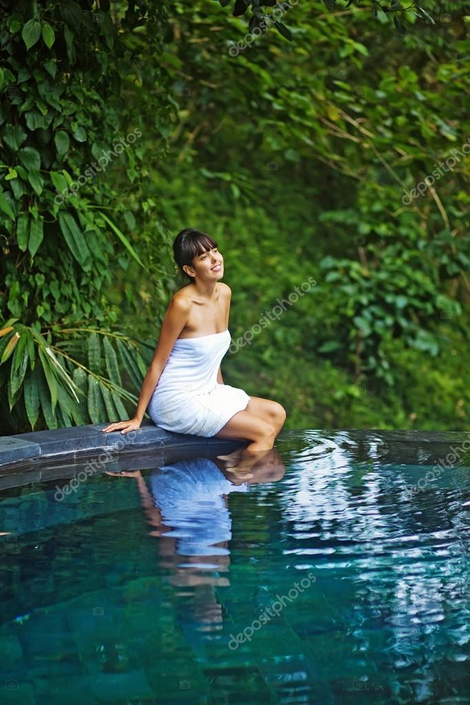 Woman In Jungle Spa Near Swimming Pool Stock Photo Apid 33573893