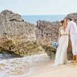 Beautiful couple on a beach — Stock Photo