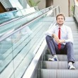 Businessman on an escalator stairs — Stock Photo