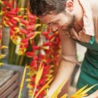 Handsome florist in his flower shop — Stock Photo
