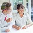 Two businesspeople working together — Stock Photo