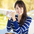 Stock Photo: Woman in autumn drinking hot tea or coffee